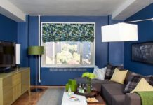 Eclectic small living room decor with a big window