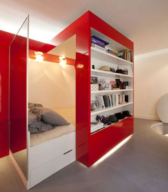 Fabulous small apartment with white bed and built in bookshelves