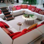 Living room seating arrangements with red and white sunken sitting area
