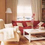 Plush living room seating idea with red and white couch