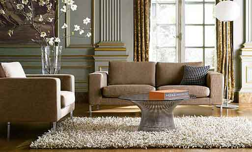 Small living room with light brown furniture