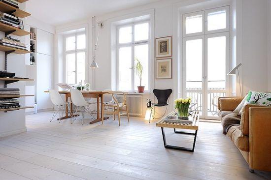 Studio apartment design with big windows and door