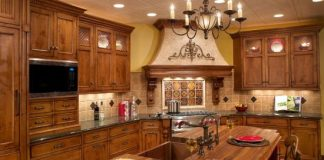 Grand Wood And Stone Tuscan Style Kitchen