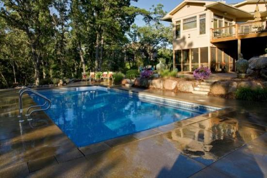 50 backyard swimming pool ideas ultimate home ideas for Back garden swimming pool