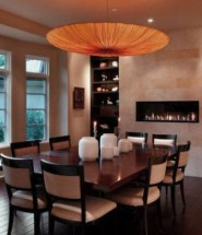 Stunning Dining Room With Wall Fireplace