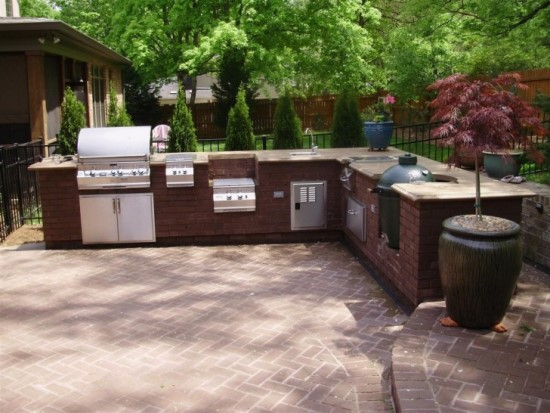 Brick Outdoor Kitchen With Grill, Stove And Oven