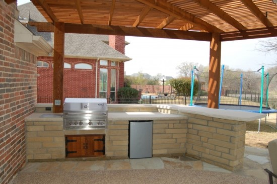 Outdoor Kitchen With Propane Burner Refrigerator And Wooden Cabinet