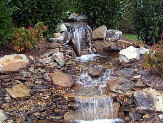 50 garden decorating ideas using rocks and stones for Yard waterfalls