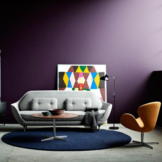 eclectic living room purple accent wall with a trendy painting