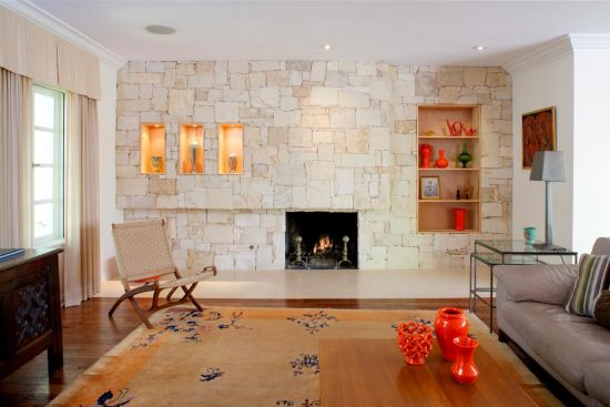 Elegant Textured Stone Accent Wall In Trendy Living Room