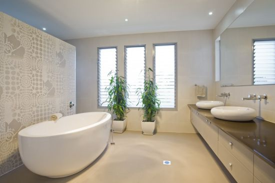 Modern bathroom decoration idea with oval tub and greens