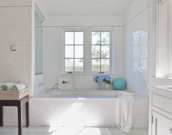 A Beach Styled Bathroom Designed With White Brick Wall Tiles