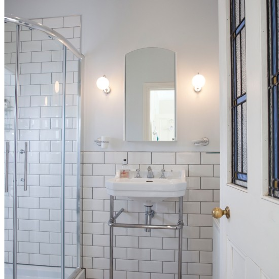bathrooms shower and sink area fitted with white brick tiles 21496