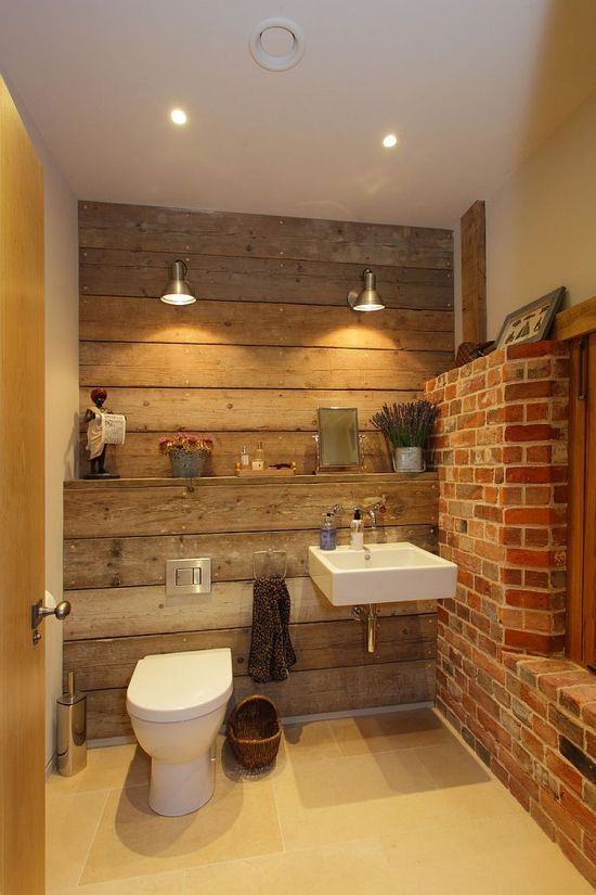 rustic bathroom design with reclaimed wood and exposed brick walls