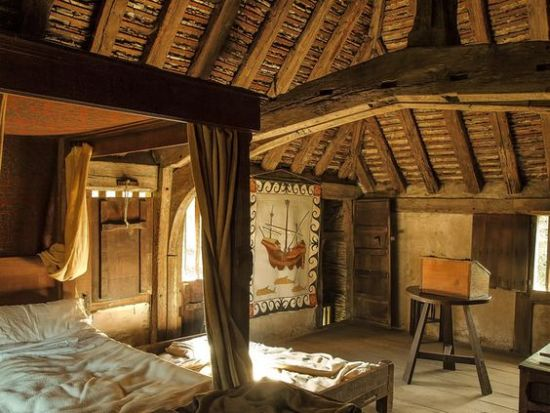 appealing medieval bedroom design with wooden seating