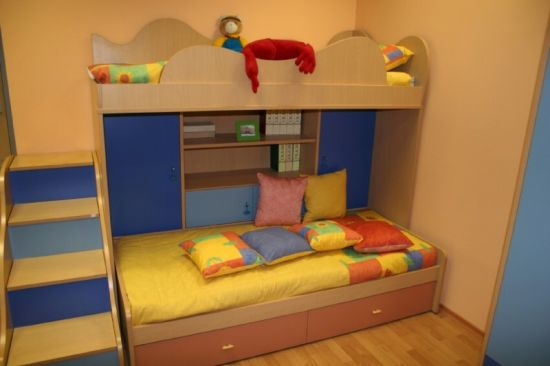 Unique Blue wood design bunk bed with yellow bedding and attached shelves and cupboards for mall space kids room