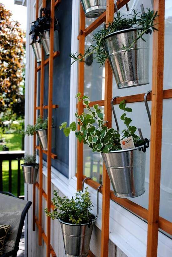Hanging little metal buckets herb garden