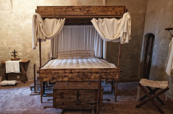 Superb Medieval Bedroom Decked Up With Bed Stool Chest And Table
