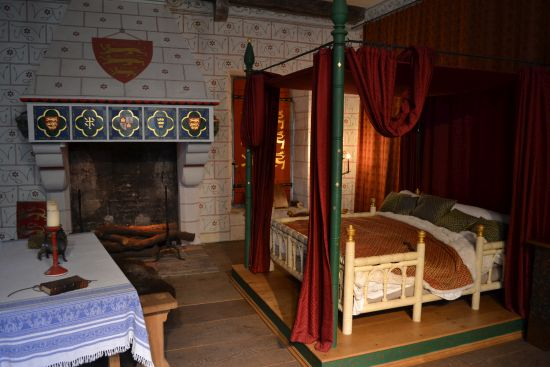 Medieval Bedroom With Bed And Wooden Bench Along With Table