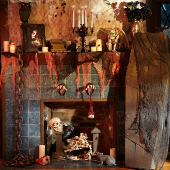 a very scary halloween decoration seen on this fireplace and mantel