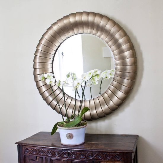 Antique bronze mirror in roundel shape