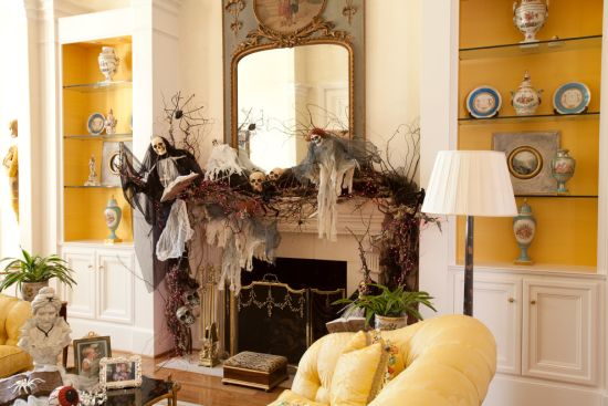 Skulls And Branch Decor On Fireplace Mantel