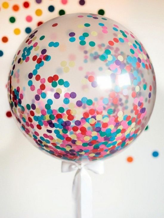 Colorful confetti decor on balloons