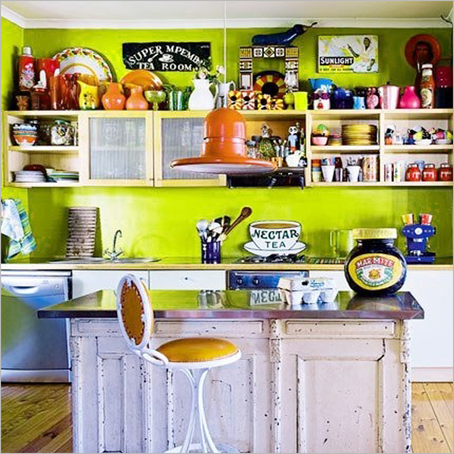 This kitchen uses open shelving to showcase a wide variety of colorful vintage items.