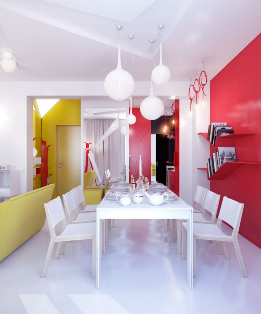 This kitchen usestwo bright colors, one on each half of the room, to bring balance and interest that balances the white floors.
