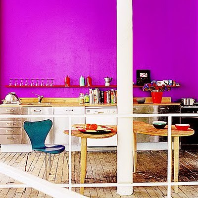 This purple wall brings life to an otherwise plain space.