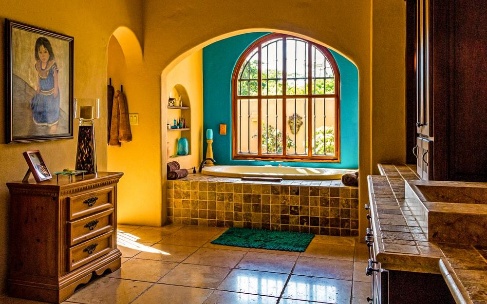 Yellow bathroom with tiles