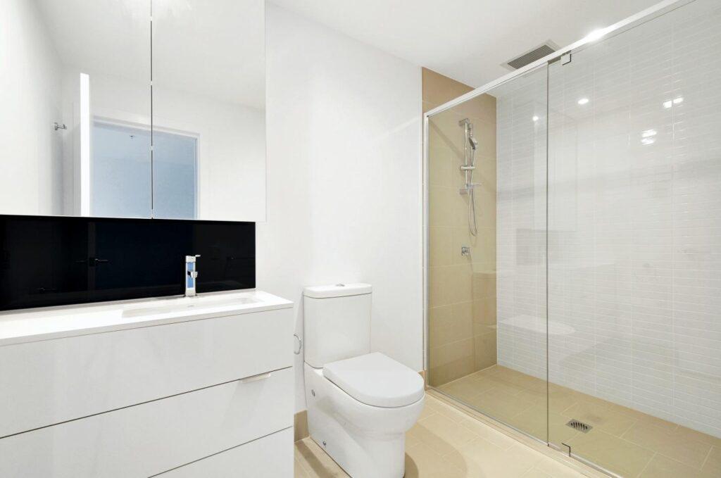 Floor to wall tempered glass door in a bathroom.