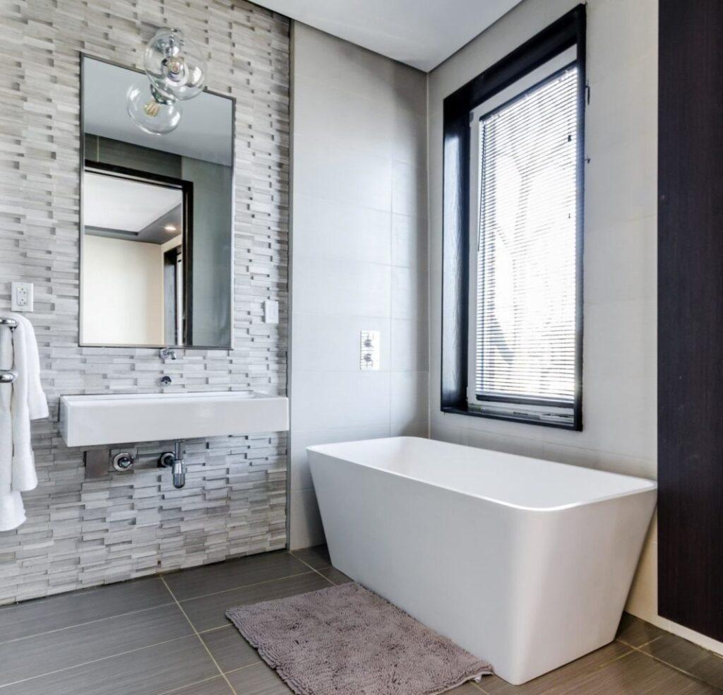 White ceramic bathtub with a large window.