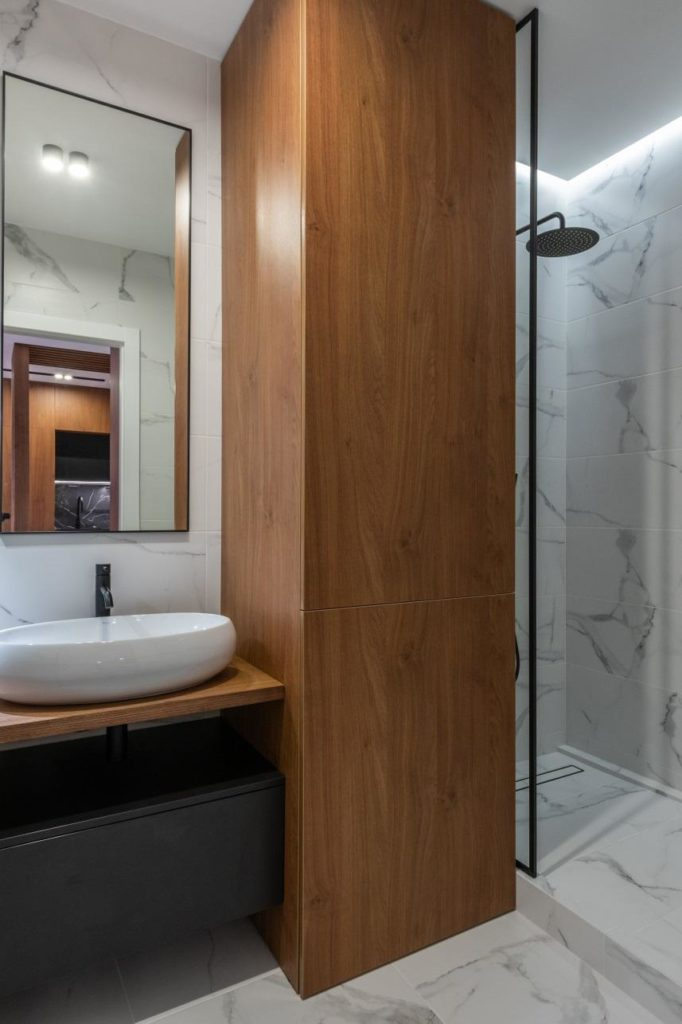 Modern bathroom with shower and furniture outside
