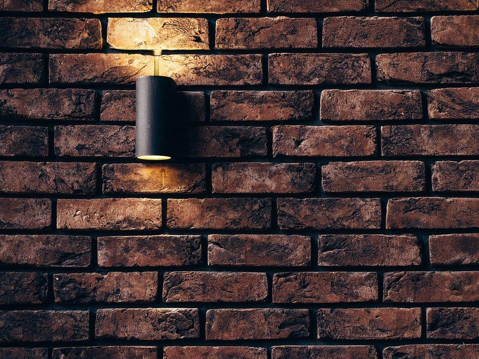Wall lamp installed over faux-brick wall